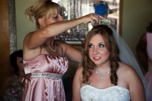 maid of honor putting veil on bride at a wedding at heather farms in walnut creek